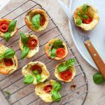 caprese mini popovers with cherry tomatoes and basil