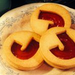jammie dodger biscuit with the letter 'J' cut out