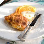 hot cross bun eggy bread with orange slices