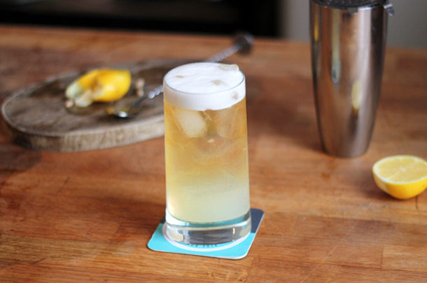 beer cocktail with lemon on the side