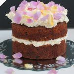 carrot cake recipe with cream cheese on top and edible petals