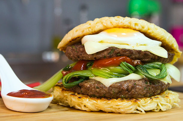 fried noodle burger bun with pak choi and egg