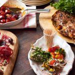 spanish platter with sundried tomatoes, sliced meats, skewered veg and cheese with olives