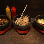 3 bowls filled with veg and eggs. asian dishes