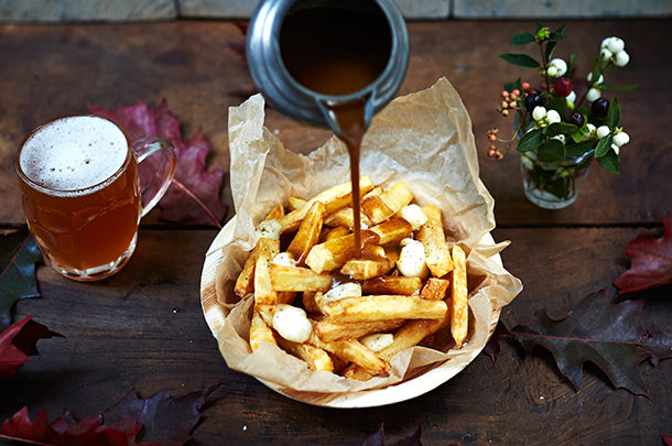 poutine - chips with gravy and creme with beer