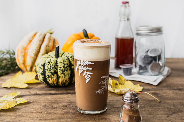 homemade pumpkin spice latte in glass with foam on top