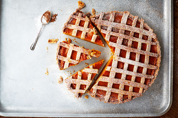 Thanksgiving pie with lattice pastry cut into slices