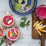 chilled beet soup with sliced eggs and radishes for garnish