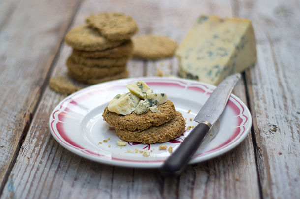 homemade oatcakes on a plate with cheese