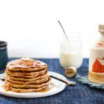 perfect pancake recipes - stack of pancakes with butter and syrup