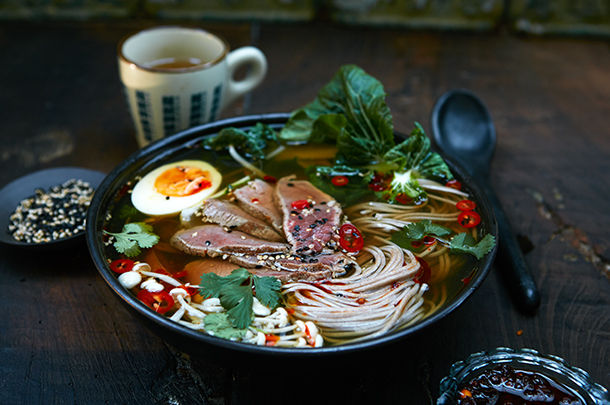 asian inspired ramen broth with egg, meat, veg and noodles