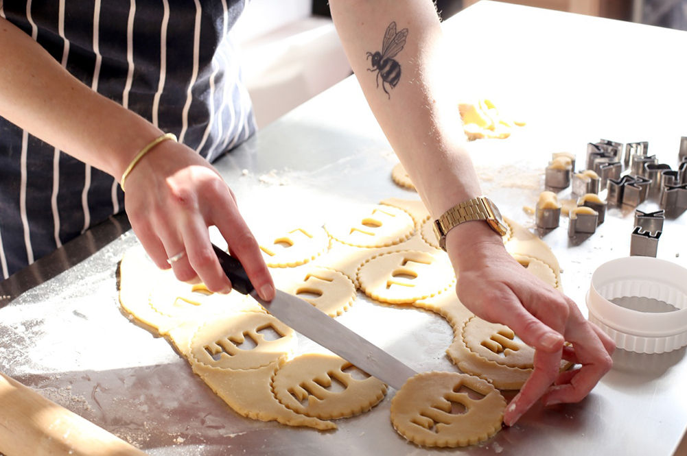 Biscuits recipes - woman cutting out biscuits shapes into dough