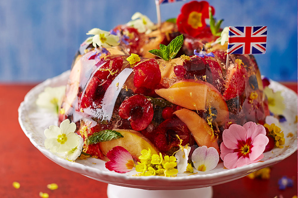 local fruit - a prosecco jelly with british local fruits scattered on top and flowers