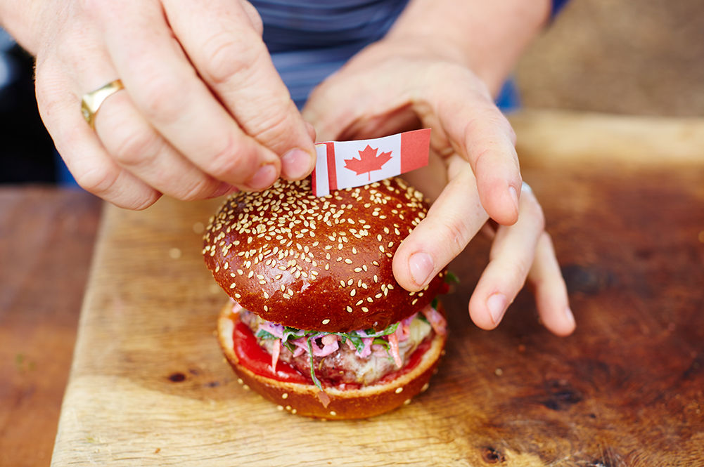 canada day burger with a canadian flag on top
