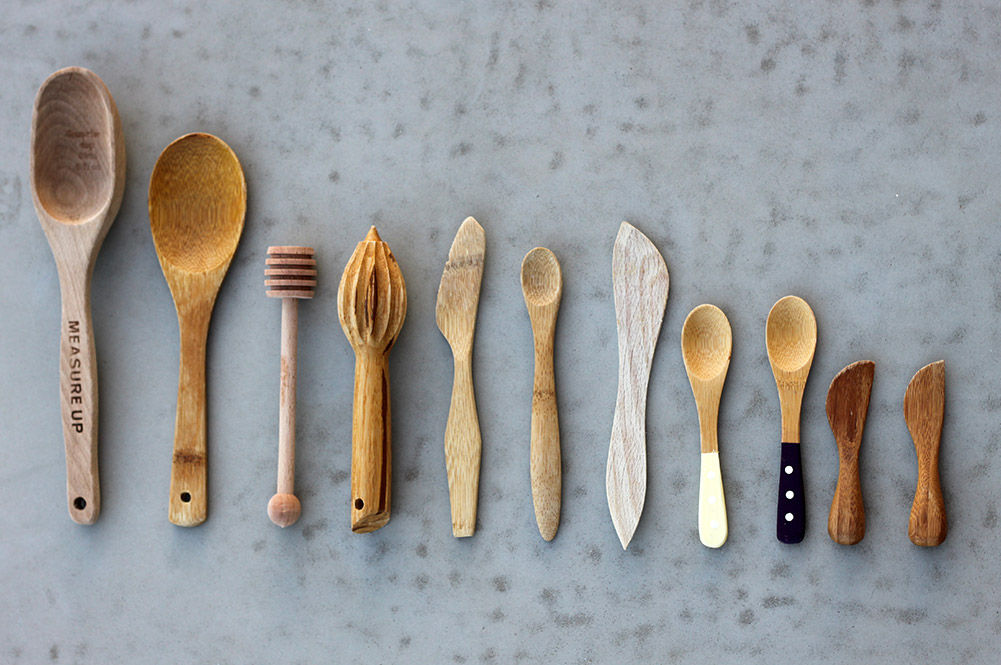 an array of wooden kitchen utensils