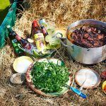 Feijoada - stew with salad and alcohol in hay