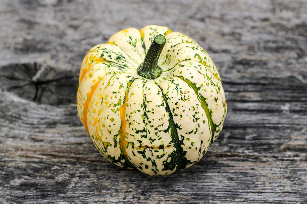 white pumpkin on wooden table