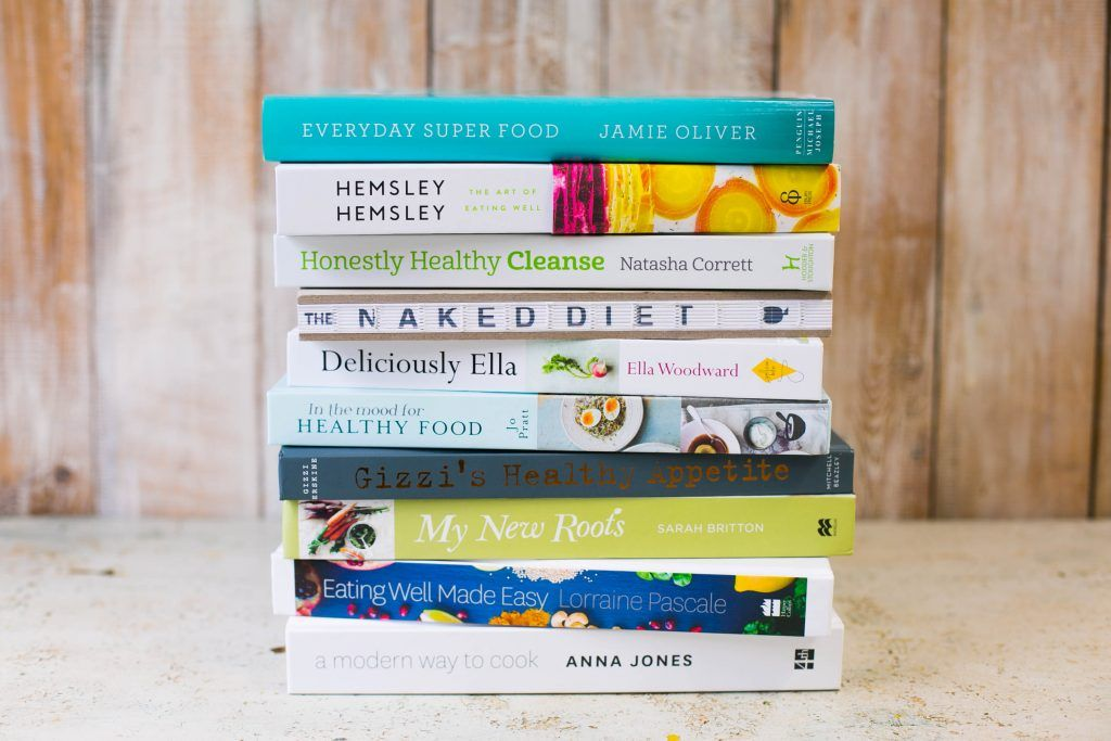 healthy cookbooks stacked on top of eachother