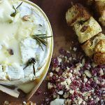 camembert with garlic and rosemary baked inside and crispy bread on the side