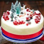 christmas cake with icing dusting and christmas decorations