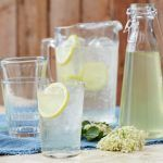 elderflower cordial in glasses with a slice of lemon