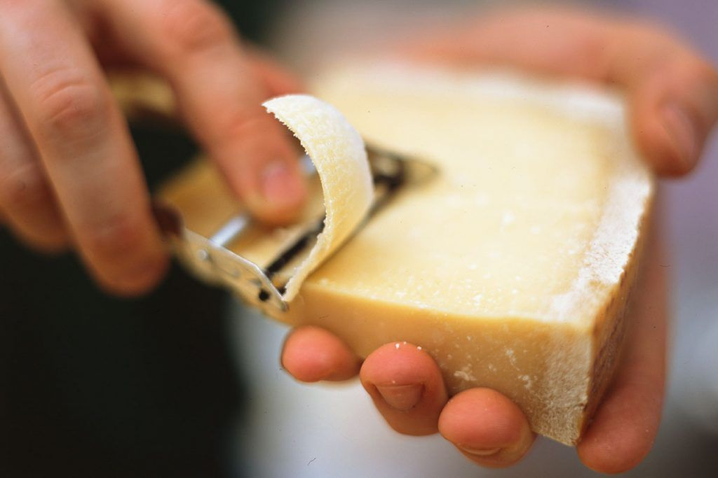 ultimate cheeseboard - cutting a thing slice of cheese
