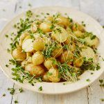 new potato salad with herbs on top