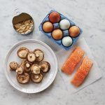 a flat lay of foods with vitamin D in