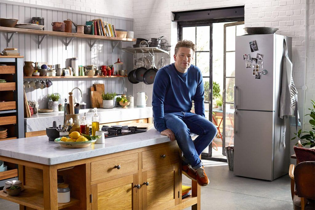jamie oliver sat on worktop in kitchen