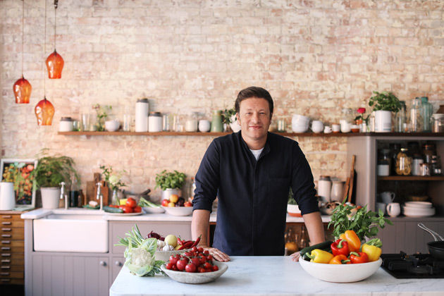 tesco ad - jamie in a kitchen with veg surrounding him
