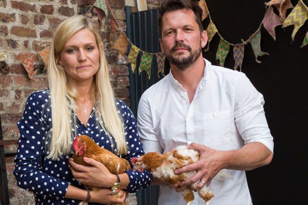 people holding pet chickens that are free range
