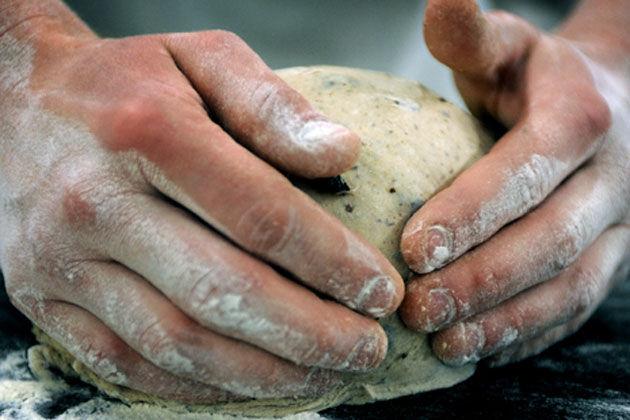 kneading dough with flour