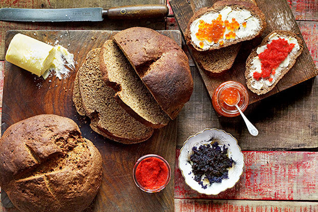 rye bread sliced with butter and fruit toppings