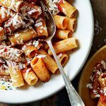 tube pasta with tomato sauce and cheese grated on top