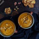 roasted pumpkin soup with bread on the side