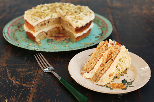 pistachio and white chocolate cake with pistachio crumbs on top