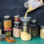 store cupboard - an array of jars filled with grains in each one