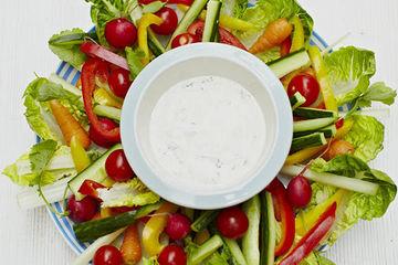 yoghurt dip with sliced veg surrounding it