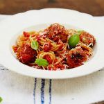 meatballs with spaghetti and basil on top