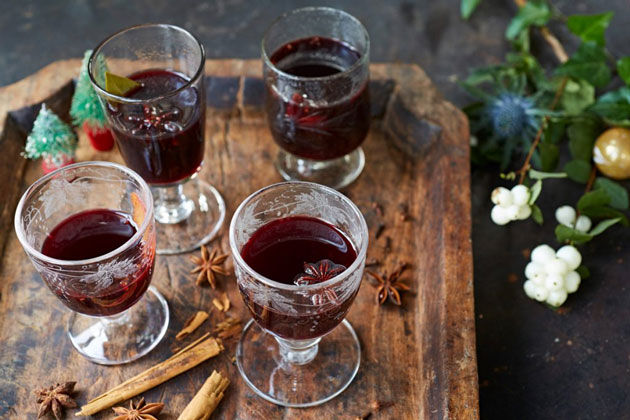 mulled wine in glasses with spices beside it