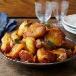 rost potatoes in a bowl with sage and orange