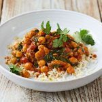 lamb and chickpea curry with coriander on top and rice