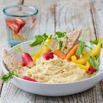 houmous dip with chopped veg, carrots, peppers, radishes and pitta bread