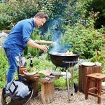 barbecued fish - jamie using BBQ outside cooking