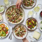 mediterranean food in separate dishes - tomatoes, olives, cheese, salad, feta