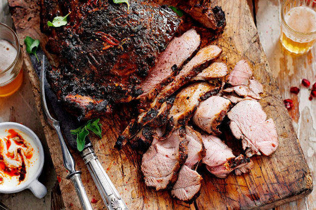 butterflied lamb recipe chopped on wooden board