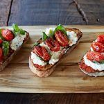 tomato ricotta bruschetta with mozzarella with dried tomatoes on top