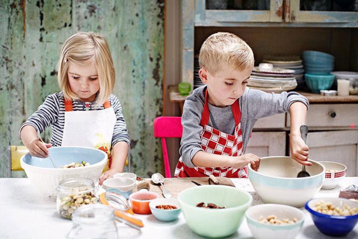 Children making edible Christmas gifts