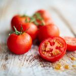 tomato recipe - chopped cherry tomatoes on a board