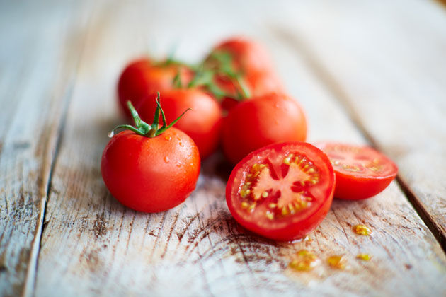 tomato recipe - chopped cherry tomatoes on a board